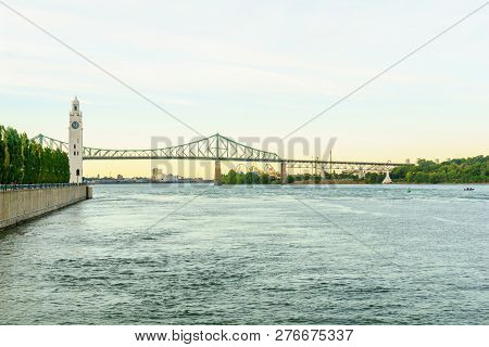 View Of The Saint Lawrence River, With The Clock Tower, And The Jacques Cartier Bridge, In Montreal,