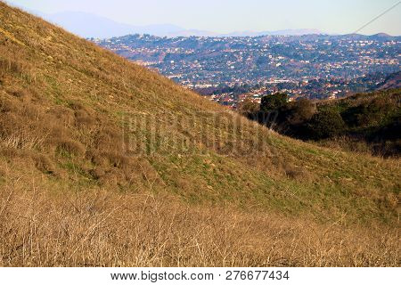 Rolling Hills With Rural Grasslands Surrounded By The City Creating A Rural Natural Island Surrounde