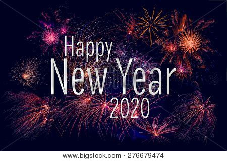 Happy New Year 2020 Greeting With Colorful Fireworks In The Night Sky
