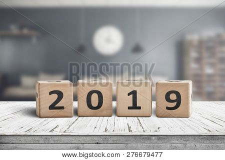 2019 Year Sign On A Wooden Table In A Living Room On A Blurry Background