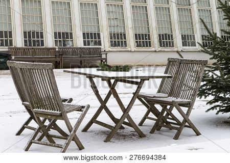 The Photo Shows Snow Covered Garden Furniture
