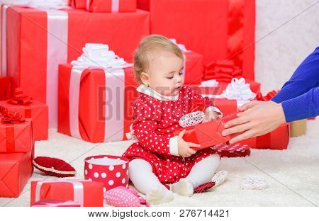Baby First Christmas Once In Lifetime Event. Little Baby Play Near Pile Of Wrapped Red Gift Boxes. G