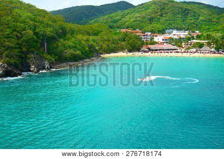 Jet Ski Tourist, Pristine Ocean And Forest. Santa Cruz Bay, Huatulco, Mexico