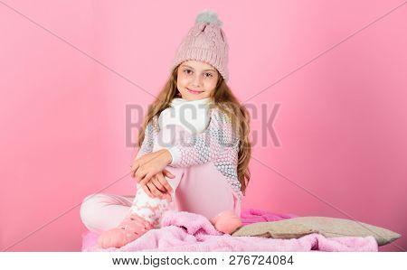 Child Long Hair Warm Woolen Hat Enjoy Warm. Warm Clothes Concept. Keep Warm And Comfortable.