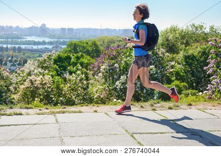Woman Runner Run Commutes To Work With Backpack, City Morning Run Commuting And Fitness Concept, Kie