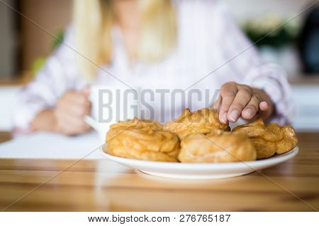 Breakfast - Close Up Of Female Hands Taking Sweet Pastry From The Plate