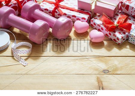 Pink Sport Dumbbells, Heart Models And Gift Boxes On Wooden Background, Valentines Sports Background