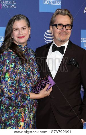 PALM SPRINGS - JAN 17:  Gisele Schmidt, Gary Oldman at the 30th Palm Springs International Film Festival Awards Gala at the Palm Springs Convention Center on January 17, 2019 in Palm Springs, CA