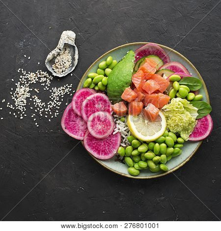 Fresh seafood recipe. Salmon and Caviar poke bowl with fresh prawn, brown rice, cucumber, pickled sweet onion, radish, soy beans edamame portioned with black and white sesame. Food concept poke bowl poster