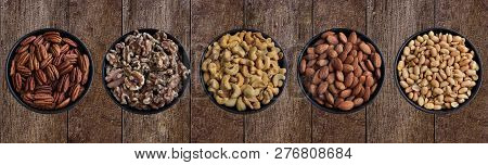 Close-up From Above Of Healthy Pecans, Walnuts, Cashews, Almonds And Peanuts In A Bowl.  View Of Dif
