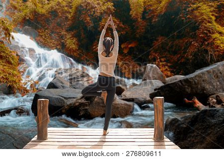 Healthy Woman Lifestyle Balanced Practicing Meditate And Zen Energy Yoga On The Bridge In Morning Th