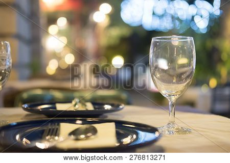 Wine Glass Setup On The Dinner Table In Luxury Dinner Party Blurry Background With Night Light