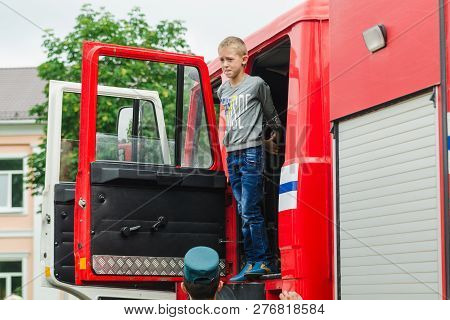 Horki, Belarus - July 25, 2018: The Boy Looks Out Of The 112 Red Rescue Service Car On A Holiday In