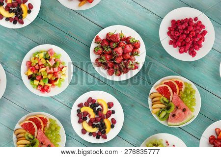 Fruit Diet. Fruits On A Plate On A Wooden Background. Healthy Food .