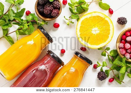 Healthy Juicy Vitamin Drink Diet Or Vegan Food Concept, Fresh Fruit And Berry. Top View Flat Lay Bac