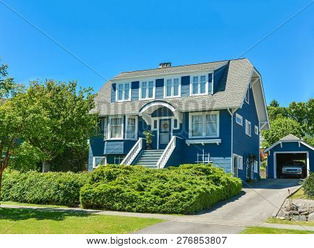 Big North American Family House With Detached Garage In Suburbs Of Vancouver. A House On Blue Sky Ba