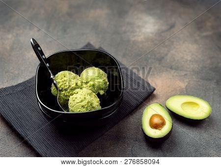 Vegan Avocado Ice Cream In Black Bowl
