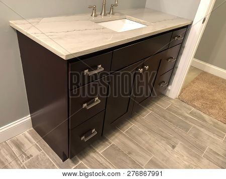 bathroom cabinet, bathroom cabinets, vanity cabinets in the bathroom, white bath cabinets, cabinet with granite countertop, vanity bathroom cabinet with white porcelain sink, contemporary style of bathroom cabinets,  bath cabinet with counter