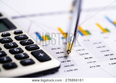 Saving Stack Coins Money, Calculator, Charts And Graphs Spreadsheet Paper. Finance, Account, Statist