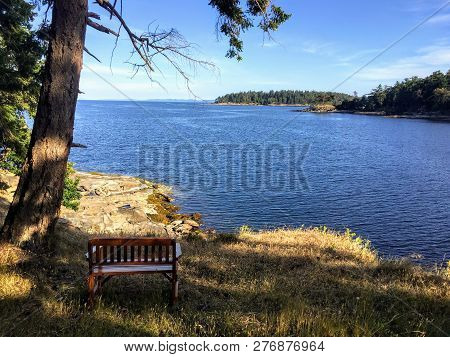 An Empty Bench Looking Out At The Beautiful Ocean Along The Coast Of British Columbia And The Gulf I