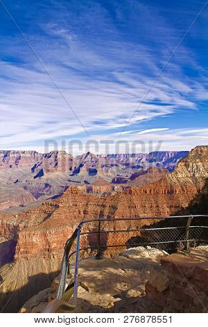 Rock Formations In A Canyon And The Board On Which The Historical Explanation Of The Grand Canyon Wa