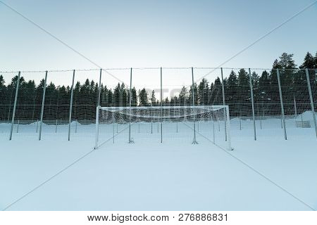 A Soccer Goal In Winter With Snow.