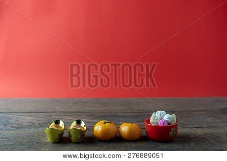 Accessories On Lunar New Year & Chinese New Year Vacation Background.orange With Gold Money And Swee