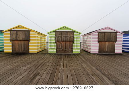 Closed Beach Huts On Pier Out Of Season
