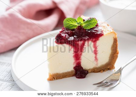 Cheesecake With Cherry Sauce. Closeup View Of Classical New York Cheesecake Served With Sweet Berry