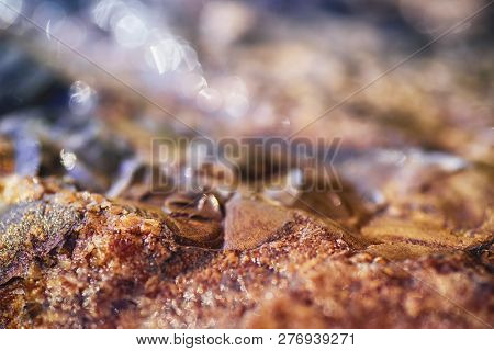 Stone Texture.natural Stone Of Brown Color, A Piece Of A Wall From A Natural Stone. Background Of Na