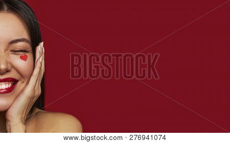 Beauty Portrait Of Brunette Happy Woman With Hearts On Her Face. Valentine's Day Portrait Of Attract