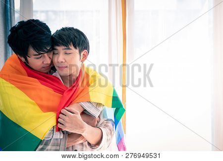 Gay Couple Romantic Moment Under Lgbt Flag.