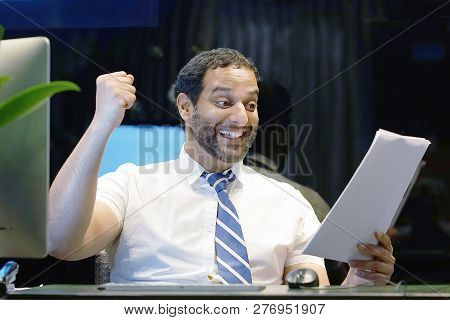 Close-up Male Office Worker. Happy Men, Enjoying The Good News In Writing. An Euphoric Male Is Happy
