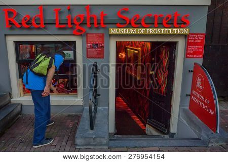 Amsterdam - June 10, 2014: Tourist At Entrance To Prostitution Museum