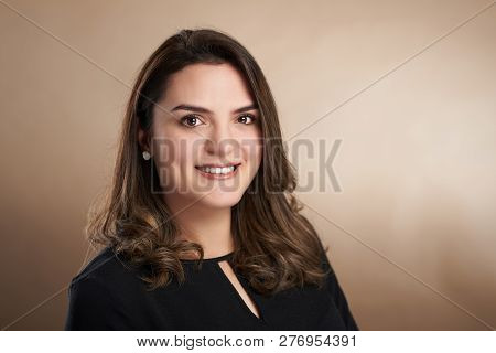 Headshot Portrait Of Young Woman In Business Outfit