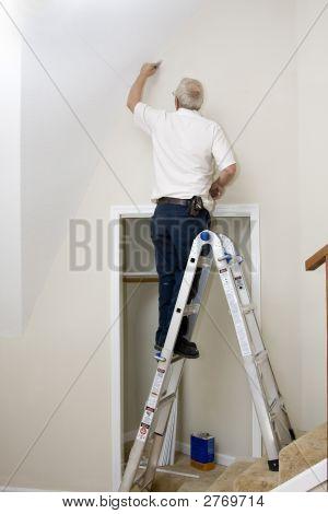 Painter On Ladder