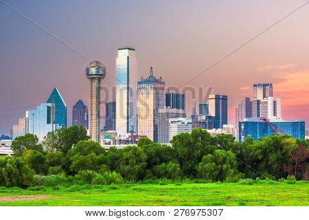 Dallas, Texas, USA downtown city skyline at dusk.