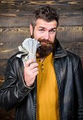 Guy mafia dealer with cash profit. Brutal man has cash money. Richness and wellbeing. Man brutal bearded hipster wear leather jacket and hold cash money. Mafia business. Illegal profit and black cash. poster