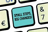 Handwriting text Small Steps Big Changes. Concept meaning Make little things to accomplish great goals Keyboard key Intention to create computer message pressing keypad idea. poster