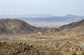 Wind turbines in the distance from a viewpoint off of Interstate 8 in the Coachella Valley of Southern California. poster