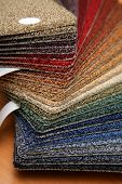 Color samples of carpet coverings in shop poster