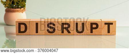 Disrupt Word Written On Wood Block. Text On Wooden Table For Your Desing, Concept.