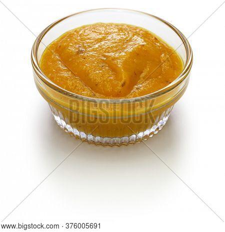 homemade mango amba sauce, israeli condiment isolated on white background