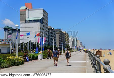 Virginia Beach, U.s.a - June 29, 2020 - The View Of The Buildings And Visitors On The Boardwalk Duri