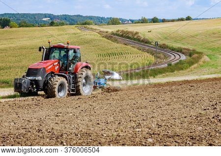 Skutech, Czech Republic, 20 September 2019: A Tractor With A Large Plow Plows A Field.