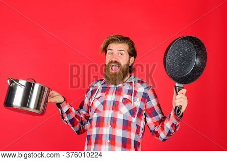 Cooking Utensils. Kitchenware. Cooking Vessels. Kitchen Advertising. Bearded Man With Saucepan And F