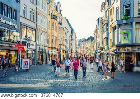 Bonn, Germany, August 23, 2019: People Tourists Walking Down Cobblestone Street In Historical City C