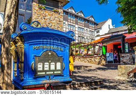 Rudesheim Am Rhein, Germany, August 24, 2019: Post Box And Traditional German Houses And Buildings W