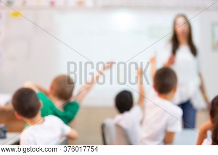 Kids with Teacher  in the classroom, Blur Image For background usage, Jewish School,  Israel