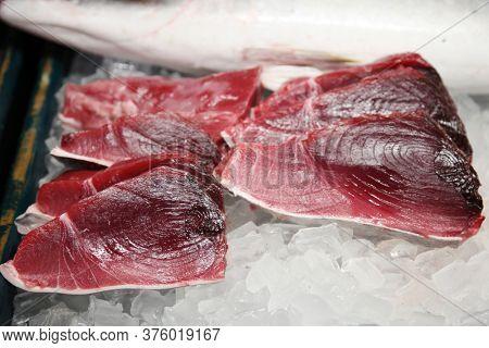 Fresh Fish. Yellow Fin Tuna. Tuna Fish Meat on ice for sale in an Open Market.